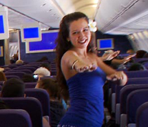 More than 20 people aboard a Hawaiian Airlines Boeing 767 flight from San Francisco to Honolulu caught their fellow passengers unaware by dancing hula...