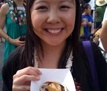 Savoring my first taste of barbecued abalone at the Kapiolani Community College Farmers' Market in Honolulu // © 2011 Candice Lee Kraughto