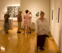 Visitors take in an exhibit at the Schaefer International Gallery at the Maui Arts & Cultural Center // © 2011 Bob Bangerter