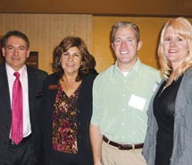From left to right: Apple Vacations vice president and general manager Mark Noennig; Apple Vacations sales manager Consuelo Valdez; Barry and Tiffany...