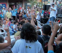 Audience members flash the shaka sign at a Maui Fridays event in Wailuku // © 2012 Gilbert and Associates