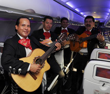 Mexican musicians performing on the inaugural nonstop flight from San Francisco to Puerto Vallarta // © 2011 Virgin America