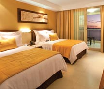 Rooms are decorated with orange and yellow hues. // © 2011 Sunset Plaza Beach Resort & Spa