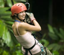 Clients on the Jungle Maya Expedition travel across the jungle by zipline. // © 2011 Thinkstock