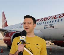 "VH1 host Jim Shearer hosts ""Top 20 Video Countdown"" and commemorates Virgin America's inaugural flight to Cancun. // © 2011 Virgin America"