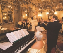 "Tauck offers an ""Imperial Evening"" in Vienna that includes dinner and performances at a private palace, Palais Pallavicini, which dates backto 1784...."