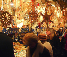Shoppers search for handmade decorations at a stall in the Nuremberg Christmas Market. // © 2011 Pride Travel / Nathan DePetris