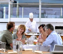 Guests can dine on an outdoor deck. // © 2012 Avalon Waterways