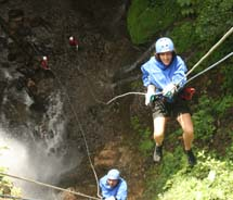 "Pure Trek takes clients rappelling down waterfalls, also known as ""canyoning,"" in Costa Rica's Arenal Volcano area. // © 2012 Irene Middleman Thomas"