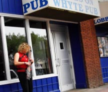 A musician plays a Chapman Stick in front of Blues on Whyte // © 2011 Gary Singh