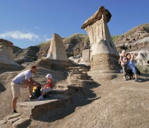 Visitors to Dinosaur Provincial Park can take a guided hike among the eerie rock formations known as hoodoos. // © 2012 Travel Alberta