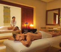 A couple enjoys the romantic and private massage treatments available at the Dreams Puerto Vallarta's world-class spa.// © 2012 AMResorts