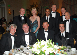 Jimmy Murphy (seated left), of Brendan Worldwide Vacations, hosted a table at the WAVE Awards Gala dinner that included several of this year's Trendsetters.