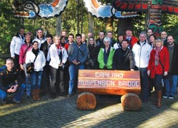 Representatives from several German tourism organizations and members of the media, including TravelAge West Editor-in Chief Kenneth Shapiro (far right), at Vancouver's Capilano Suspension Bridge on a