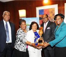From left: Jamaica's Director of Tourism John Lynch; Jamaica's Director General in the Ministry of Tourism Carrole Guntley; honoree Winsome Charlton;...