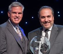 <p>Craig Davis (left), Visit Pittsburgh and Destination & Travel Foundation, presents the Spirit of Hospitality Award to Randy A. Garfield, Disney...