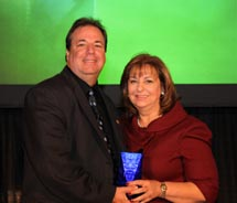 Olga Ramudo accepts the award for ASTA's 2011 Travel Agent of the Year from former ASTA president, Chris Russo. // © 2011 ASTA