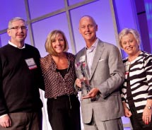 Travelink accepts American Express' award for Travel Agency of the Year. // © 2011