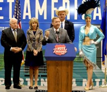 From left to right: Roger Dow, Kristin KcMillan and Tom Collins join Rossi Ralenkotter (at podium) and a Vegas showgirl during the first stop of the...