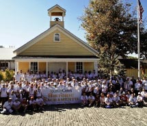 The Tourism Cares for Historic Sacramento volunteers in front of the newly repainted Old Sacramento Schoolhouse Museum // © 2012 Tourism Cares
