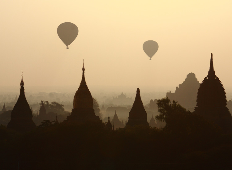 Many consider the ancient and once forbidden city of Bagan, Myanmar to be the world's best location for a hot air balloon ride. // (c) 2013 Thinkstock