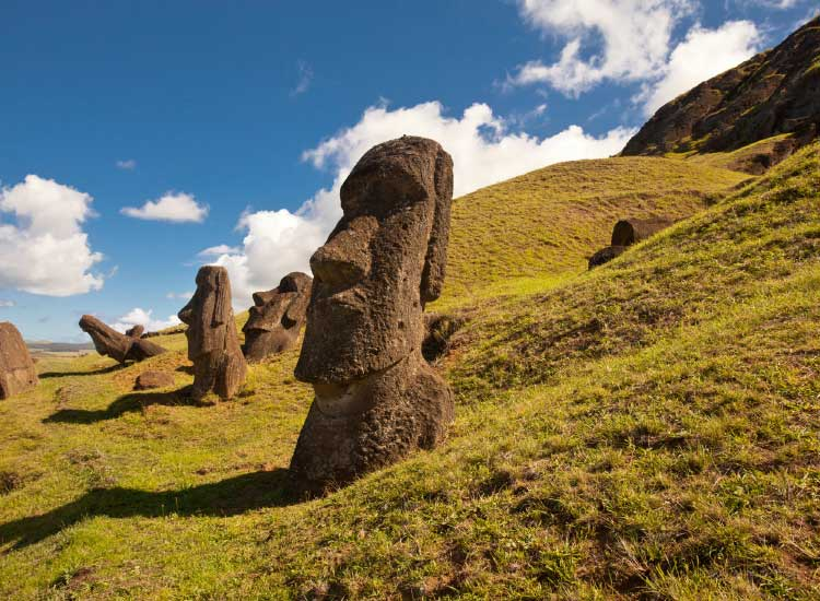Standing among Easter Island's enormous moai stone statues engages even the most experienced travelers. // © 2013 Thinkstock