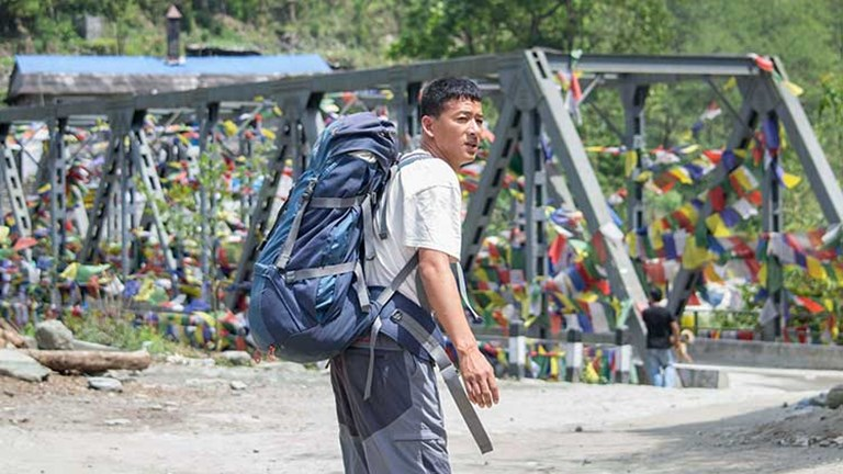 Tej, a Peregrine Adventures local guide, at a Modi Khola River crossing // © 2015 Mindy Poder