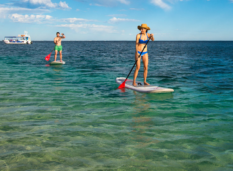 The area is known for its water sports, from stand-up paddleboarding to surfing. // © 2016 Coral Coast