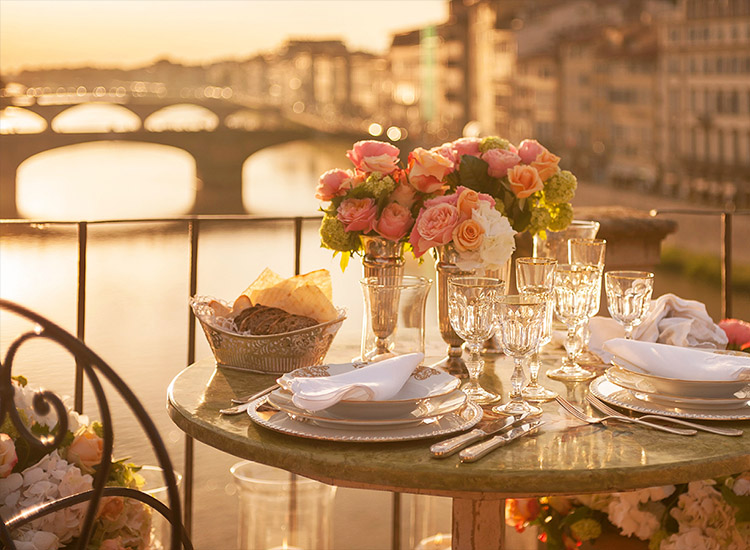 "Four Seasons Hotels & Resorts offers ""Extraordinary Experiences,"" a program with local perspective-focused activities, such as an intimate dinner on the Ponte Vecchio bridge in Florence, Italy. // © 2014 Four Seasons Hotels & Resorts"