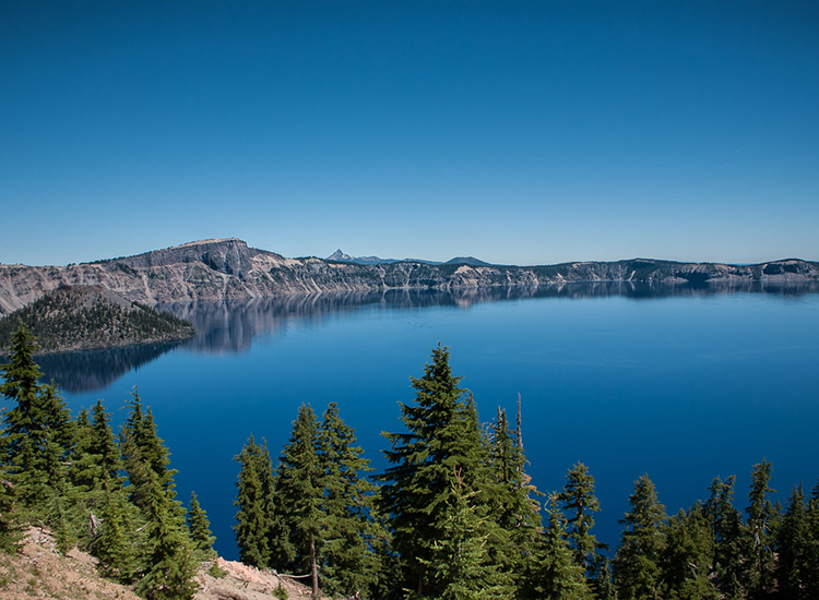 The startling blue Crater Lake, part of the PCT, is the deepest lake in the U.S. and the ninth deepest in the world. // © 2014 Creative Commons user jesterg42