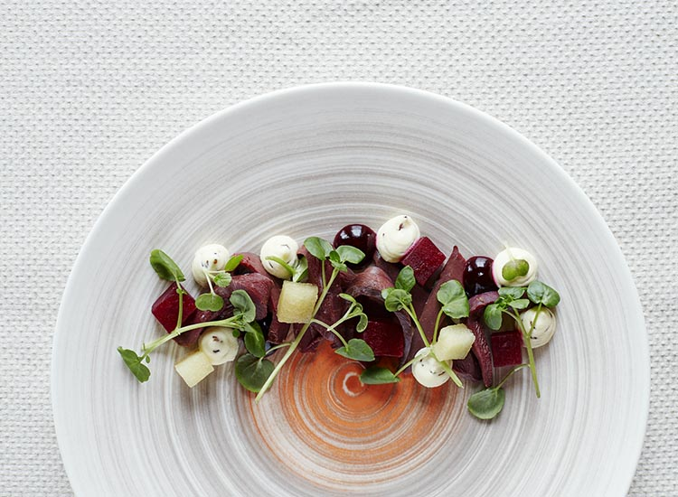 Indulge in Nordic-inspired cuisine at the on-site Ranga Restaurant, such as smoked puffin with spiced cream cheese, beetroot gel and apples. // © 2017 Brent Darby