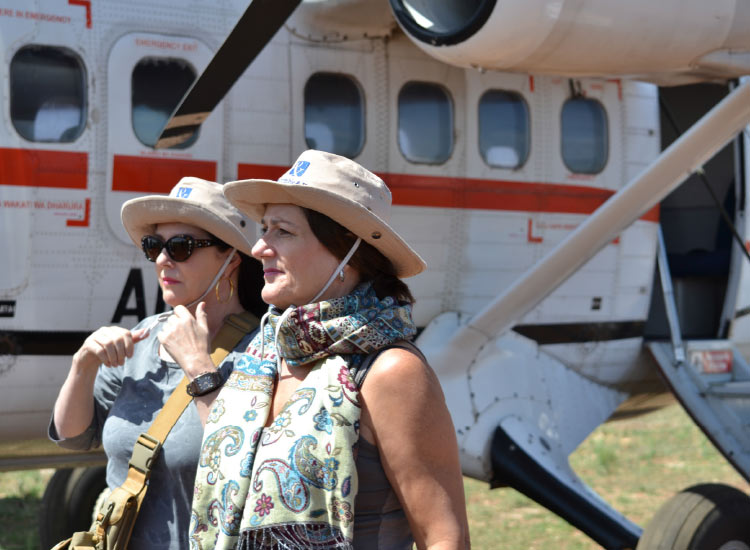 Travel agent Susan Talbot (right) and sister Lucie exit a plane from Samburu to the Mara. // © 2015 Mindy Poder