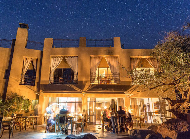 Guests dine under the stars at Feynan Ecolodge. // © 2018 Feynan Ecolodge/Brian Scannell