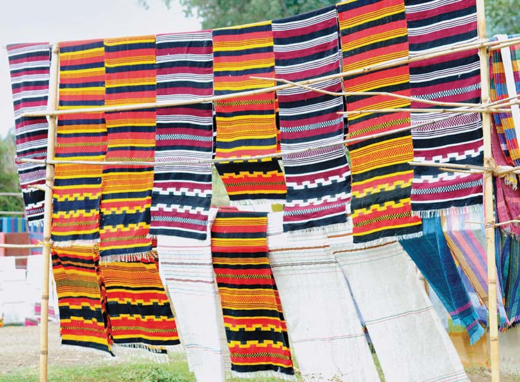 Colorful woven textiles created by people of the Dorze tribe in Arba Minch, Ethiopia // © 2014 Cox & Kings