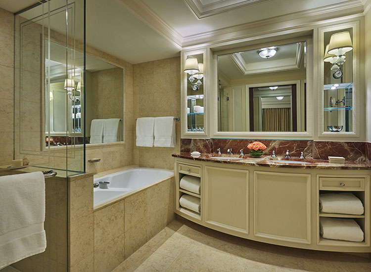 One of two bathrooms in the Ambassador Suite, which includes a soaking tub and a separate shower // © 2015 Christian Horan/Four Seasons Hotel Doha