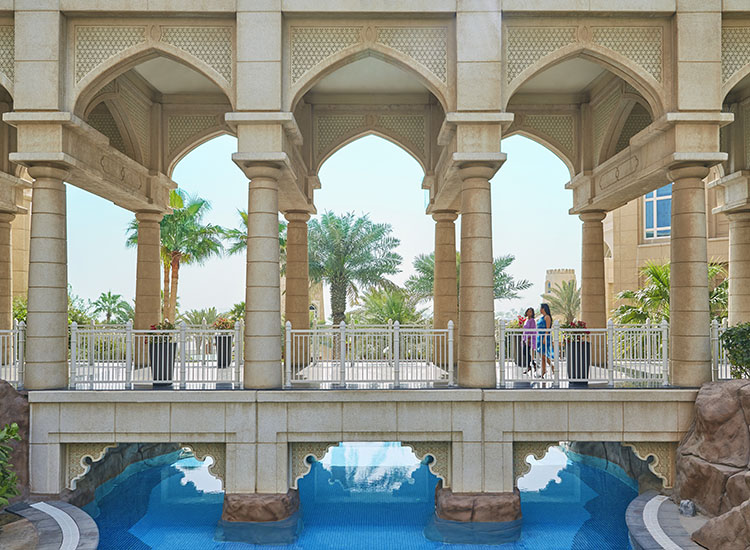 Swim under the bridge to a secluded pool. // © 2015 Christian Horan/Four Seasons Hotel Doha