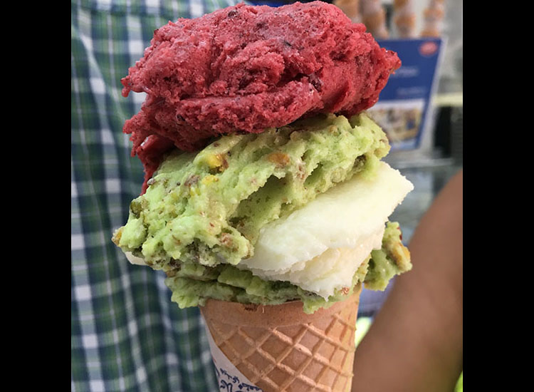 This cone features layers of pistachio, raspberry and ashta ice cream flavors. // © 2017 Giselle Abcarian