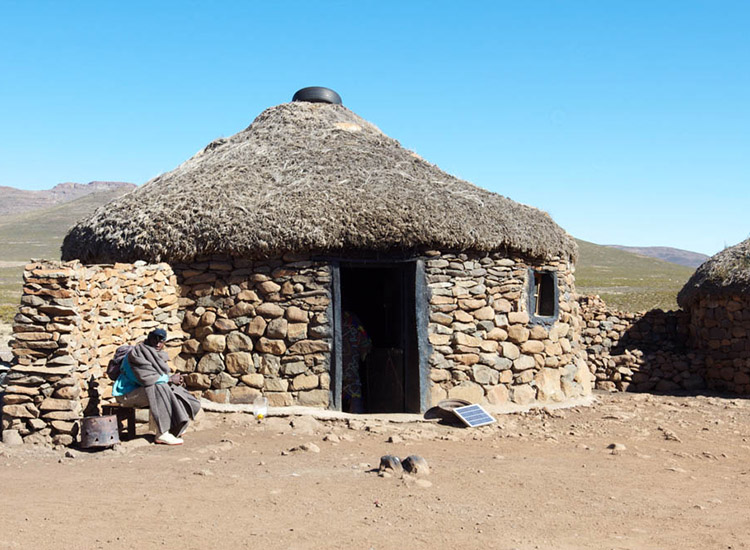 A traditional house with a mud and thatched roof in Sani Pass. // © 2014 Devin Galaudet
