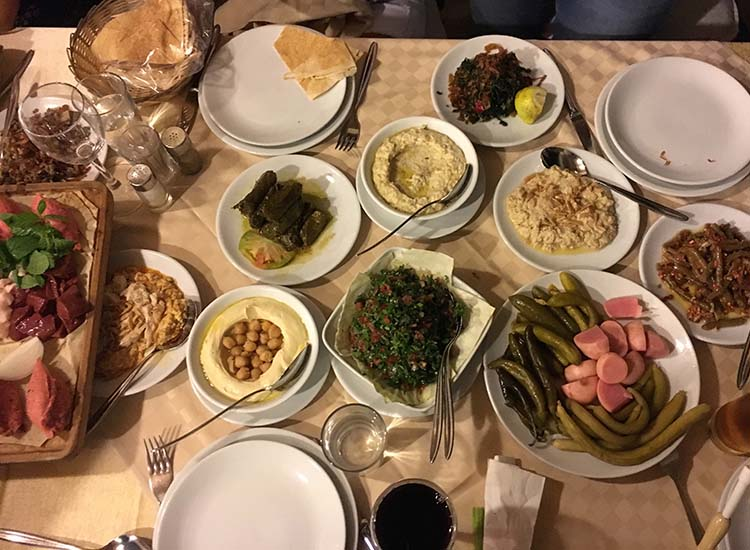 A traditional mezza dinner in Lebanon can take up to four hours and features a variety of hot and cold dishes. // © 2017 Giselle Abcarian