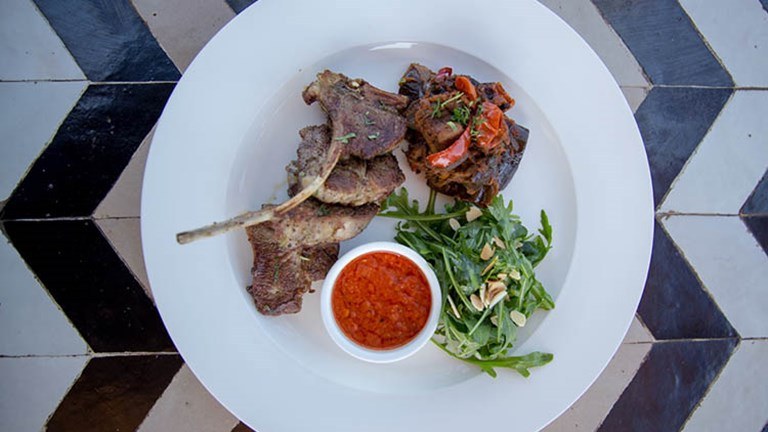 Nomad serves modern Moroccan fare, ranging from lamb chops served with spiced tomatoes, ratatouille and harissa (pictured) to more traditional tagines and mezze plates. // © 2018 Nomad