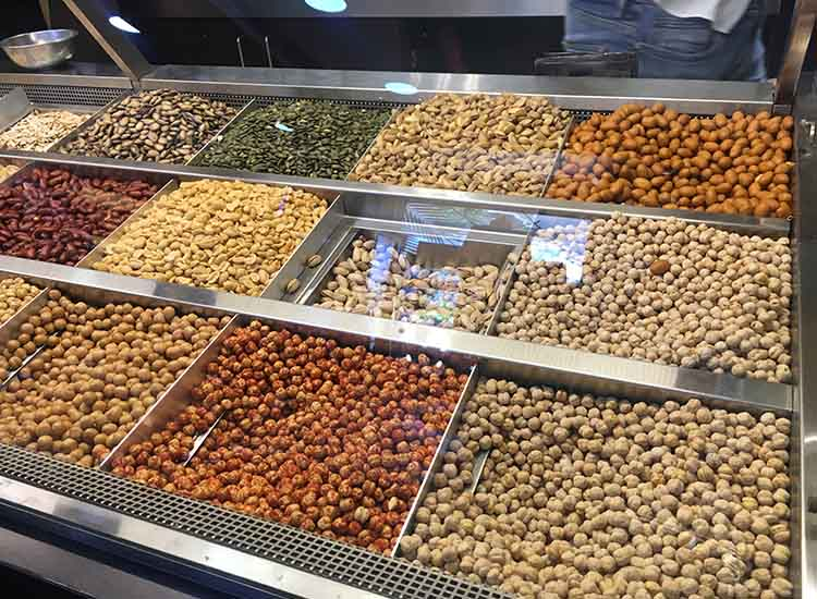 Before leaving Lebanon, travelers can fill a few bags with a variety of Lebanese nuts at Alrifai. // © 2017 Giselle Abcarian