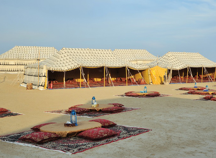 After enjoying a traditional Arabic barbecue dinner, guests can retire to Bedouin-style tents for the night. // © 2015 Gulf Adventures