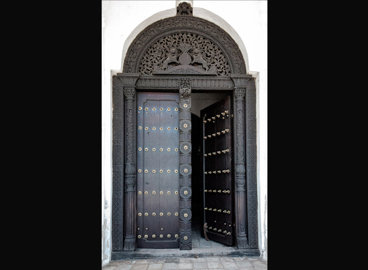 Elaborately carved wooden doors that have become the icons of Stone Town. // (c) 2013 Bob Demyan