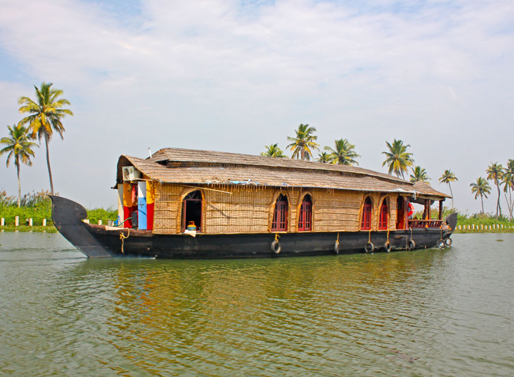 Rice boats are a great way to explore Kerala's backwaters// (C) 2013 Shutterstock