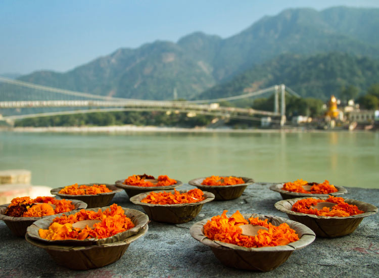 Ram Jhula is one of the iron suspension bridges used to get across the Ganges River in Rishikesh. // © 2014 Thinsktock