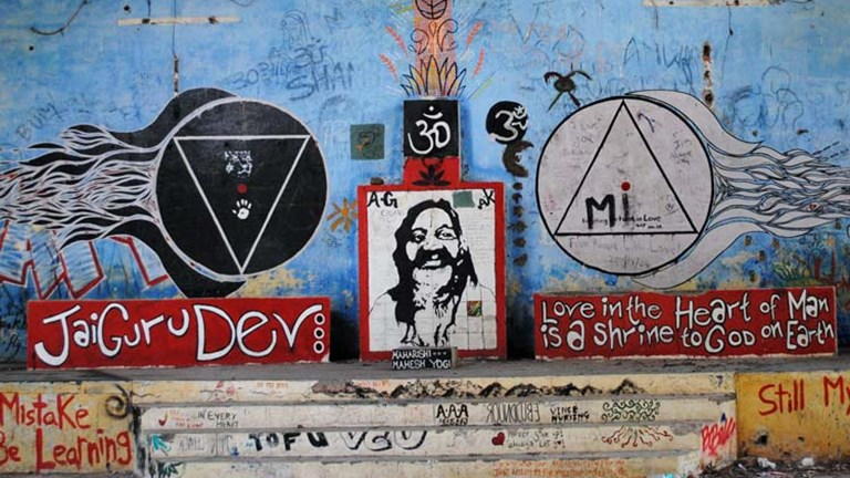 A group of guerilla artists transformed the former meditation hall into a gallery of Beatles-related paintings and lyrics. // © 2014 Mindy Poder
