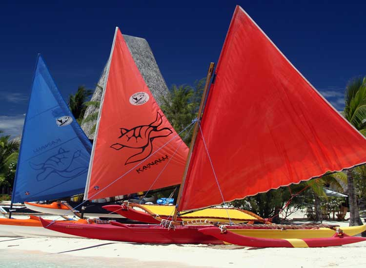Polynesian sailing canoes on Matira Beach // (c) 2013 Wim Lippens
