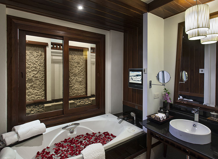 Bathrooms are spacious and may even feature a private, closed-in waterfall. // © 2017 RatiLanna Riverside Spa Resort Chiang Mai