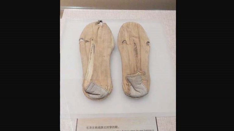 Museum visitors can view a range of Mao artifacts, including this pair of shoes he is said to have worn during a battle in Shaanxi. ‬// © 2014 Shane Nelson