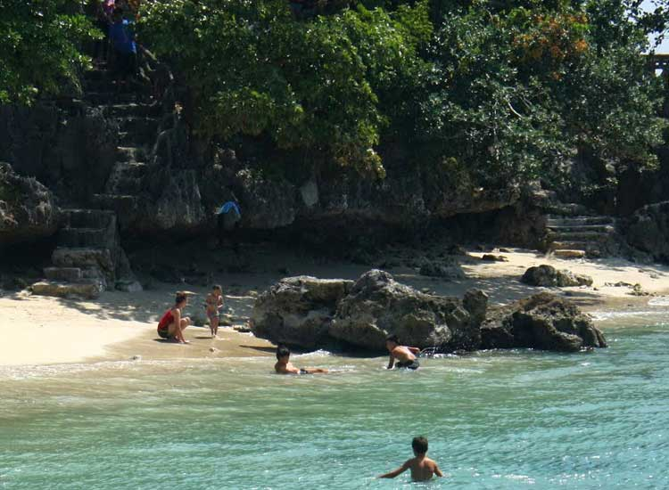 Quezon Island is an ideal spot for swimming, with gentle green waters enveloping the shoreline. // (c) 2013 Nila Do